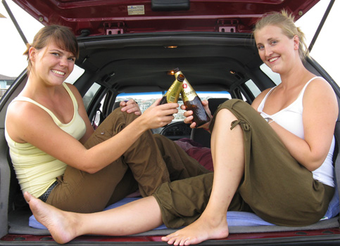 Two girls drinking beers in the back of a used car from Sydneycars