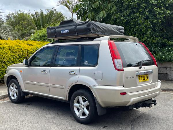Used Nissan 4x4 for sale with Roof Tent - rear passenger side view