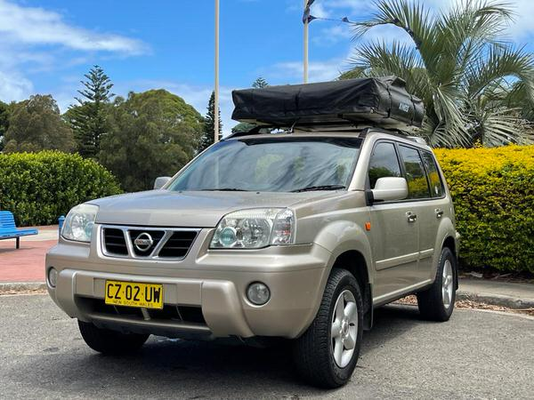Used Nissan 4x4 for sale with Roof Tent - front passenger side view